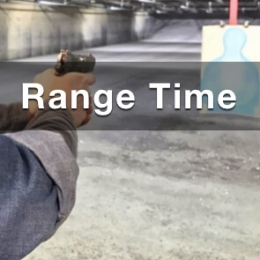 rage time at double action gun shop pic showing arm extended with a handgun pointing at a target at an indoor shooting gun range